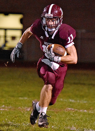 (Brad Davis/The Register-Herald) Woodrow Wilson's Logan Cook carries the ball against Parkersburg Friday night.