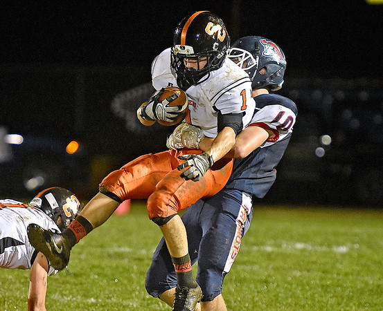 (Brad Davis/The Register-Herald) Independence's Connor Gibson lifts Summers County's C.J. Shrewsbury into the air prompting the ref's whistle during the Patriots' win over Summers County Friday night in Coal City.