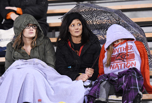 Summers County fans fight the elements Friday during their game against Pocahontas in Hinton. (Chris Jackson/The Register-Herald)
