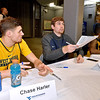 (Brad Davis/The Register-Herald) Two former in-state, Class A high school players Brent Daniels and Chase Harler sign autographs Friday night at Beckley-Raleigh County Convention Center.
