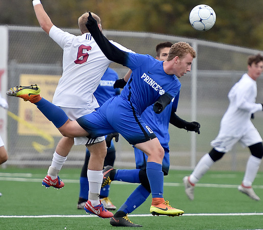 (Brad Davis/The Register-Herald) Princeton's Andrew Trimble leaps for a header during the Tigers' loss to Woodrow Wilson Saturday afternoon at the YMCA Paul Cline Memorial Sports Complex.