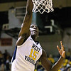 (Brad Davis/The Register-Herald) WVU's Lamont West dunks during the Mountaineers' exhibition game with the Golden Bears Saturday night at the Beckley-Raleigh County Convention Center.
