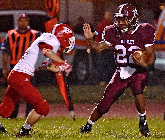 (Brad Davis/The Register-Herald) Woodrow Wilson's Meeko Harris carries the ball off a kick return against Parkersburg Friday night.