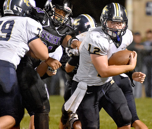(Brad Davis/The Register-Herald) Nicholas County quarterback Tate Mays turns a corner and gets loose for a big gain during the Grizzlies' road win over the Mavericks Friday night in Lindside.