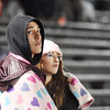 Two Shady Spring fans huddle in a blanket during their game against Clay County Friday in Shady Spring. (Chris Jackson/The Register-Herald)