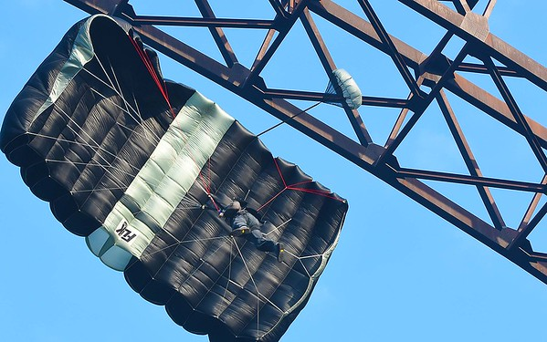 Base jumper jumps off the New Gorge Bridge during Bridge Day in Fayetteville.<br /> (Rick Barbero/The Register-Herald)