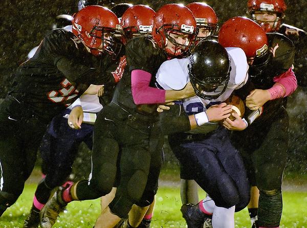 (Brad Davis/The Register-Herald) Liberty's defense takes down James Monroe back Grant Mohler Friday night in Glen Daniel.