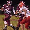 (Brad Davis/The Register-Herald) Woodrow Wilson's Peyton Thomas carries the ball against Parkersburg Friday night.