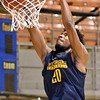 (Brad Davis/The Register-Herald) WVU's Brandon Watkins throws down a dunk during the Mountaineers' practice Friday night at Beckley-Raleigh County Convention Center.