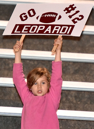 (Brad Davis/The Register-Herald) A young Antonio Leopardi fan and/or family member never wavers in her support for him during the Flying Eagles' game against Capital Friday night at Van Meter Stadium.