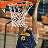 (Brad Davis/The Register-Herald) WVU's Elijah Macon throws down a dunk during the Mountaineers' practice Friday night at Beckley-Raleigh County Convention Center.