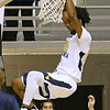 (Brad Davis/The Register-Herald) WVU's Brandon Watkins dunks during the Mountaineers' exhibition game with the Golden Bears Saturday night at the Beckley-Raleigh County Convention Center.