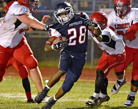 (Brad Davis/The Register-Herald) Independence running back Marcus Guy cuts through Liberty defenders as he carries the ball during the Patriots' win over the Raiders Friday night in Coal City.