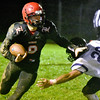 (Brad Davis/The Register-Herald) Liberty's Jacob Bailey rumbles ahead Friday night in Glen Daniel.