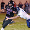(Brad Davis/The Register-Herald) James Monroe's Devin Johnson carries the ball against Nicholas County Friday night in Lindside.