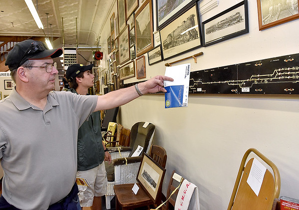 (Brad Davis/The Register-Herald) Indiana resident Rodney George (near) and his nephew Garrett George check out the Hinton Railroad Museum during Railroad Days Sunday afternoon.