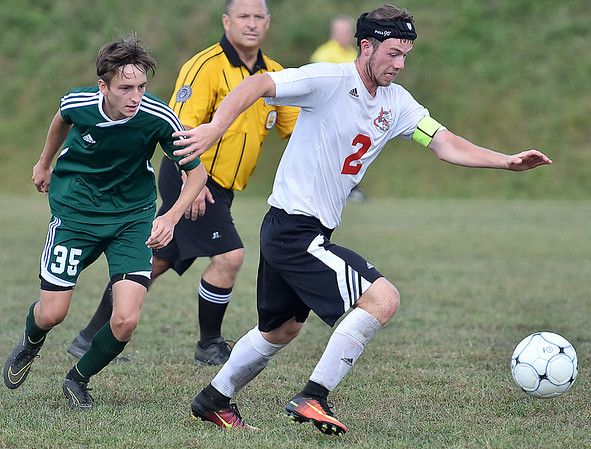 (Brad Davis/The Register-Herald) Oak Hill's Blake Wingrove dribbles as Winfield's Michael Englund pursues him during the Red Devils' home loss to the Generals September 24.