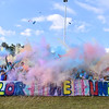 (Brad Davis/The Register-Herald) Colored powder flies as the many participants of this year's United Way of Southern West Virginia's Color Me United 5K Walk/Run throw it into the air in unison at the conclusion of the event Sunday afternoon at the Raleigh County Memorial Airport.