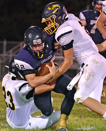 (Brad Davis/The Register-Herald) Greenbrier West running back Cameron Hunter is taken down by Buffalo's Stephen Booth, left, and Ethan Burgess Friday night in Charmco.