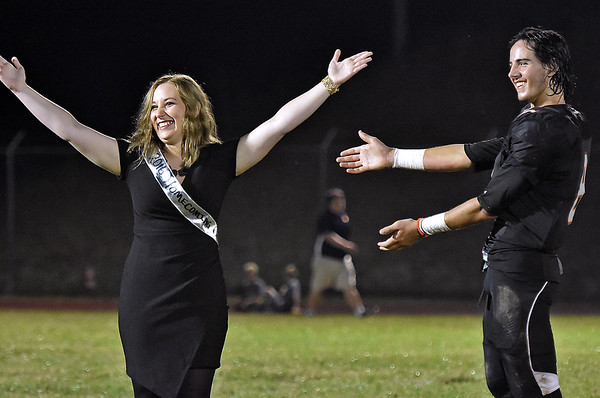 (Brad Davis/The Register-Herald) Liberty senior Ceanna Canterbury is congratulated by escort Jacob Bailey after being crowned homecoming queen during halftime Friday night in Glen Daniel.