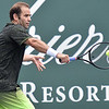 (Brad Davis/The Register-Herald) Pete Sampras returns a ball during he and partner Shelby Rogers' mixed doubles matchup against John McEnroe and Venus Williams during The Greenbrier Champions Tennis Classic Sunday afternoon in White Sulphur Springs.