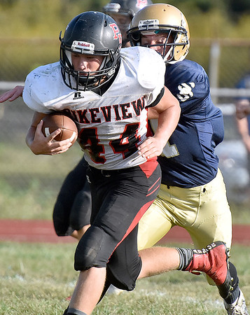(Brad Davis/The Register-Herald) PikeView running back Evan Rose carries the ball following a reception during the Tigers' homecoming game win over the Panthers Saturday afternoon.