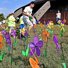 (Brad Davis/The Register-Herald) Volunteers aasemble a garden of flowers symbolizing attendees' involvement in the battle against Alzheimer's disease while the teams walk during the annual Walk to End Alzheimer's event Saturday morning at the Beckley-Raleigh County Convention Center. Participants had four different colors of flower to choose from based on their personal experience with the disease. Yellow represents caregivers and supporters of loved ones who have it. Blue represents those currently diagnosed with it, orange stands for supporters of the cause to eliminate the disease and purple represents those who have lost loved ones to Alzheimer's.