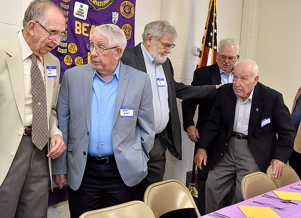 (Brad Davis/The Register-Herald) A group of 15 past presidents and district governors still living get organized and into position for a group photo prior to a special dinner and ceremony honoring them at the Beaver Lions Club Thursday evening.