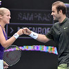 (Brad Davis/The Register-Herald) Current pro Shelby Rogers and resort Tennis Professional Emeritus Pete Sampras congratulate each other during their mixed doubles matchup against John McEnroe and Venus Williams during The Greenbrier Champions Tennis Classic Sunday afternoon in White Sulphur Springs.