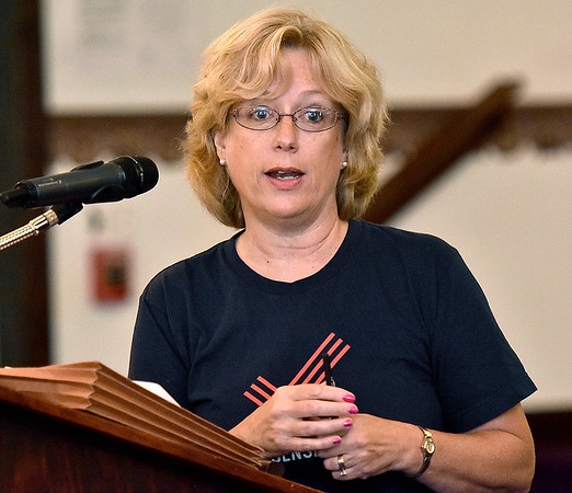 (Brad Davis/The Register-Herald) Dee Childers, head of the West Virginia chapter of Moms Demand Action for Gun Sense in America, speaks during a community meeting and discussion on gun violence hosted by the organization Saturday afternoon at Heart of God Ministries.