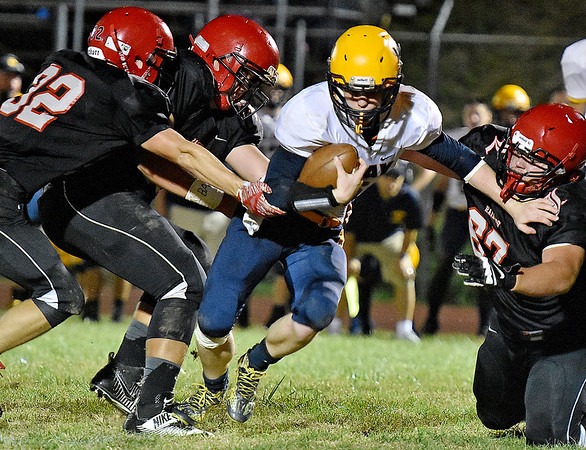 (Brad Davis/The Register-Herald) Liberty defenders (from left) A.J. Milam, Frank Vanover and Robbie Bryson bring down Clay County running back Reece Nichols Friday night in Glen Daniel.