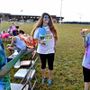 (Brad Davis/The Register-Herald) From left, Felicity Ferri, Courtney Shumate and Megan Rock chill out following the United Way of Southern West Virginia's Color Me United 5K Walk/Run Sunday afternoon at the Raleigh County Memorial Airport.