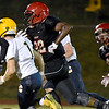 (Brad Davis/The Register-Herald) Liberty running back Johnny Drafton rumbles forward for a big gain against Clay County Friday night in Glen Daniel.