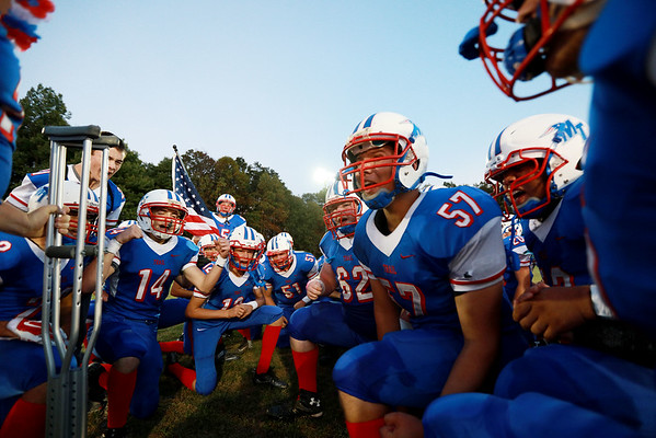Midland Trail football team members get fired up prior to kickoff of their game against Van Friday in Hico. (Chris Jackson/The Register-Herald)
