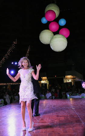 Margaret O'Neal waving to the crowd during the 5th Annual Dancing with the Stars event Friday evening at the Beckley Raleigh County Convention Center. <br /> (Rick Barbero/The Register-Herald)