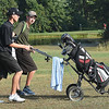 Caleb Cook, of Westside, left, walks with Brett Laxton, of Wyoming East, up the par 5, 4th fairway at Grandview Country Club during the Class AA Regional High School Golf Tournament. <br /> (Rick Barbero/The Register-Herald)