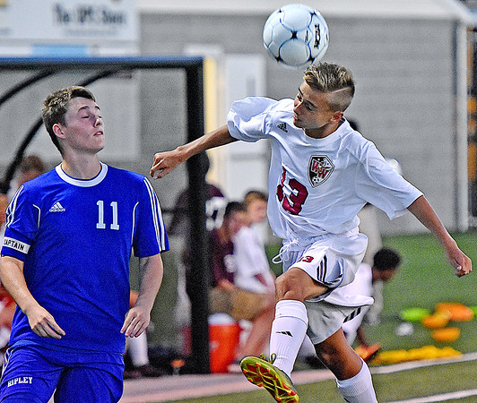 (Brad Davis/The Register-Herald) Woodrow Wilson's Isaac Bragg beats Ripley's Remington Boyce to a header during the Flying Eagles' loss to the Vikings Thursday night at the YMCA Paul Cline Memorial Sports Complex.