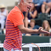 (Brad Davis/The Register-Herald) John McEnroe continues his humorous antics during he and partner Venus Williams' mixed doubles matchup against Pete Sampras and Shelby Rogers during The Greenbrier Champions Tennis Classic Sunday afternoon in White Sulphur Springs.