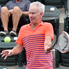 (Brad Davis/The Register-Herald) John McEnroe returns a ball during he and partner Venus Williams' mixed doubles matchup against Pete Sampras and Shelby Rogers during The Greenbrier Champions Tennis Classic Sunday afternoon in White Sulphur Springs.