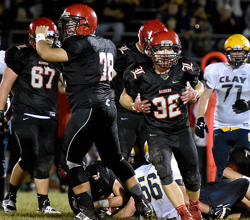 (Brad Davis/The Register-Herald) Liberty defense 1st-half fumble recovery against Clay County Friday night in Glen Daniel
