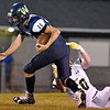 (Brad Davis/The Register-Herald) Greenbrier West quarterback Hunter Bevins is taken down in the backfield by Buffalo's Tyler Morlachetta Friday night in Charmco.
