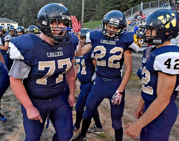(Brad Davis/The Register-Herald) Greenbrier West's Tyler Cales (#77) gets his teammates fired up prior to the Cavaliers' home game against Buffalo Friday night in Charmco.