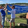 (Brad Davis/The Register-Herald) From left, Beckley Area Foundation members Tom Lemke, David Stewart, Brett Eckley and Conrad Cooper hang one of a handful of banners notifying the public of a household hazardous waste drop-off at Chase Bank in Beaver Friday evening. The drop-off is October 8th at the Beckley-Raleigh County Convention Center from 8:00 a.m. to 2:00 p.m.