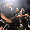 (Brad Davis/The Register-Herald) Liberty band member Casey Cook plays a Raiders guitar Friday night in Glen Daniel.