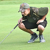 Brett Laxton, looks over his putt on the par 4, 5th hole at Grandview Country Club during the Class AA Regional High School Golf Tournament. <br /> (Rick Barbero/The Register-Herald)