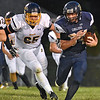 (Brad Davis/The Register-Herald) Greenbrier West running back Colton Kessler carries the ball as Buffalo's Zach Boyer pursues Friday night in Charmco.