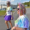 (Brad Davis/The Register-Herald) Shelby Wolfe, left, and Kacy Burgess walk during the United Way of Southern West Virginia's Color Me United 5K Walk/Run Sunday afternoon at the Raleigh County Memorial Airport.