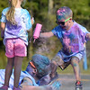 (Brad Davis/The Register-Herald) Four-year-old Braden Wolfe decides a volunteer needs way more coloring during the United Way of Southern West Virginia's Color Me United 5K Walk/Run Sunday afternoon at the Raleigh County Memorial Airport.