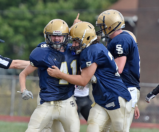 (Brad Davis/The Register-Herald) Shady Spring receiver Bryce Hodges, left, is mobbed by teammates after making a long touchdown reception during the Tigers' homecoming win over PikeView Saturday afternoon.