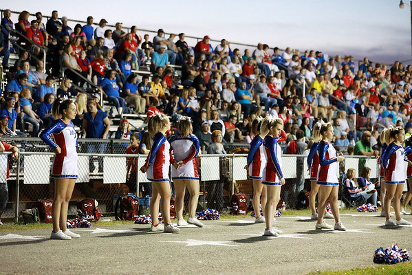 Midland Trail cheerleaders look on after 14 un-answered points from Van during their football game Friday in Hico. (Chris Jackson/The Register-Herald)